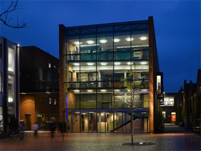 The adjacent Performing Arts Centre, linked by a bridgr, contains a recital hall and glazed foyer, photo: Nick Kane